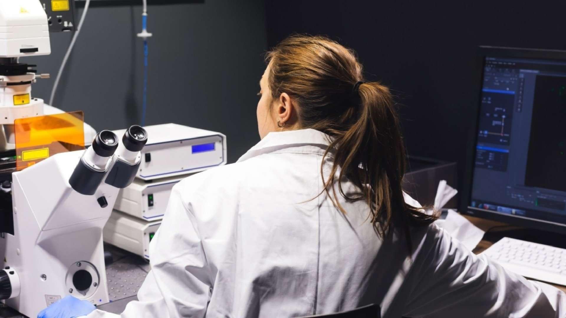 Health Scientist staring at scientific equipment