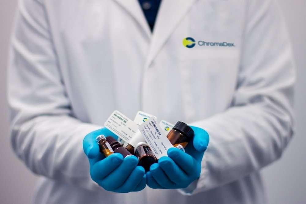 Pharmacists holding medicines.
