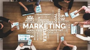 Marketing and related words with people and laptops