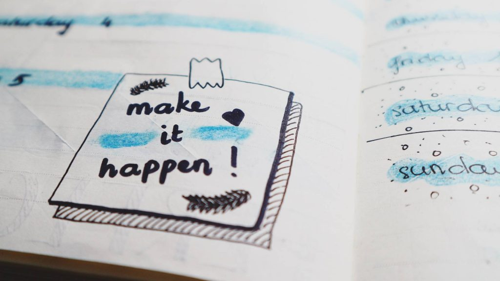 """a daily daily with a doodle of a post-note with """"Make it Happen!"""" written on it."""