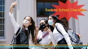 3 college students with masks taking a selfie