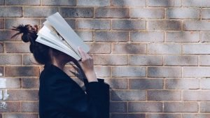 Women with open book in her face