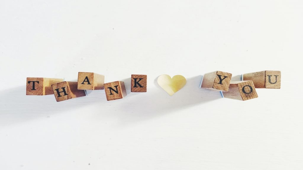 """The word, """"Thank You"""" spelled out in wooden blocks with a heart in the middle."""